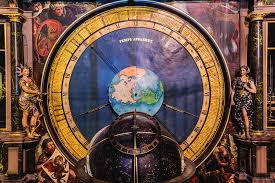 A large celestial globe in front of the planetary clock